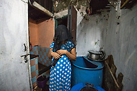 India; Maharashtra; Mumbai; Bombay. The red light district, Kamatipura.<br />             Nasima Shaikh (Rani) is from Kolkata. She was married at the age of 16 to a man from the same city. He told her that he would take her to Mumbai but instead, took her to Nasik where they stayed at his aunt's house. After 3 days he told Nasima that he had to leave because of an urgent work. He went to his hometown leaving Nasima with his uncle and aunt, but she was unaware of the evil intentions they had in their mind about her. They brought her to RLA in K.P 12th lane and sold her there to a brothel. They told her to stay there for a while and that they will come back soon to take her. Nasima patiently waited a whole day expecting them to come back but that didn't happen. Next day her madam (brothel-keeper) woke her up early and told her to take a bath and be ready. She also made her cut her hair short. She was forced to do make-up and stand on the street. At first Nasima use to cover her body with a scarf, but her landlady didn't like that and told her to remove it.<br />       Whenever she refused to do this work she was beaten severely by her many times. Her madam told her that your uncle and aunt have sold you here and now it's your responsibility to pay me by working here. In the beginning she didn't like men coming and touching her but later she compromised. She agreed to sleep with them, against her will as the landlady forced her and she had to support her two children who were living in the village with her parents. She was completely devastated, feeling alone and hopeless. <br />        She has been in this business for 15 years. One day our Savera staff met Nasima and made a good relationship with her by frequently visiting her during outreach. After few days, we told her about our tailoring course and she happily accepted our call. She says that after joining Savera she founded joy, peace and life of freedom.   She makes about $70 a week in the brothel, about $2 a customer.