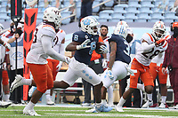 CHAPEL HILL, NC - OCTOBER 10: Michael Carter #8 of North Carolina is chased by Rayshard Ashby #23 of Virginia Tech on a 27-yard run during a game between Virginia Tech and North Carolina at Kenan Memorial Stadium on October 10, 2020 in Chapel Hill, North Carolina.