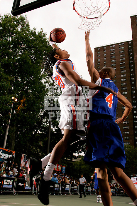 Chris Allen (20) goes up for a dunk with defense by Anthony Randolph (4) during the Elite 24 Hoops Classic game on September 1, 2006 held at Rucker Park in New York, New York.  The game brought together the top 24 high school basketball players in the country regardless of class or sneaker affiliation.