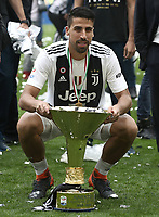Calcio, Serie A: Juventus - Hellas Verona, Torino, Allianz Stadium, 19 maggio, 2018.<br /> Juventus' Sami Khedira celebrates with the trophy during the victory league ceremony at Torino's Allianz stadium, 19 May, 2018.<br /> Juventus won their 34th Serie A title (scudetto) and seventh in succession.<br /> UPDATE IMAGES PRESS/Isabella Bonotto