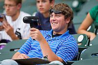 Steve McCray of the Winston-Salem Dash uses a radar gun to chart the speed of pitches during the game against the Wilmington Blue Rocks at BB&T Ballpark on June 10, 2012 in Winston-Salem, North Carolina.  The Dash defeated the Blue Rocks 2-0.  (Brian Westerholt/Four Seam Images)