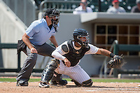 Charlotte Knights catcher Omar Narvaez (14) frames a pitch as home plate umpire Ryan Additon looks on during the game against the Charlotte Knights at BB&T BallPark on May 22, 2016 in Charlotte, North Carolina.  The Knights defeated the Braves 9-8 in 11 innings.  (Brian Westerholt/Four Seam Images)