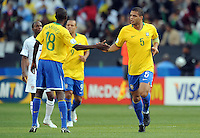 Felipe Melo of Brazil is congratulated by team-mate Ramires after scoring the opening goal. Brazil defeated USA 3-0 during the FIFA Confederations Cup at Loftus Versfeld Stadium in Tshwane/Pretoria, South Africa on June 18, 2009.