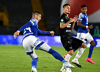 BOGOTA - COLOMBIA, 17-12-2020: Matias de los Santos de Millonarios F. C. y Juan David Rodriguez de Once Caldas disputan el balon, durante partido entre Millonarios F. C. y Once Caldas de la Semifinales por la Liguilla BetPlay DIMAYOR 2020 jugado en el estadio Nemesio Camacho El Campin de la ciudad de Bogota. / Matias de los Santos of Millonarios F. C. and Juan David Rodriguez of Once Caldas figth for the ball, during a match between Millonarios F. C. and Once Caldas of the Semifinals for the BetPlay DIMAYOR 2020 Liguilla played at the Nemesio Camacho El Campin Stadium in Bogota city. / Photo: VizzorImage / Luis Ramirez / Staff.