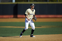 Wake Forest Demon Deacons shortstop Patrick Frick (5) on defense against the Gardner-Webb Runnin' Bulldogs at David F. Couch Ballpark on February 18, 2018 in  Winston-Salem, North Carolina. The Demon Deacons defeated the Runnin' Bulldogs 8-4 in game one of a double-header.  (Brian Westerholt/Four Seam Images)