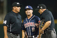 Arizona Wildcats head coach Jay Johnson (2) talks with umpires David Savage (L) and Scott Cline (R) during Game 6 of the NCAA College World Series against the Oklahoma State Cowboys on June 20, 2016 at TD Ameritrade Park in Omaha, Nebraska. Oklahoma State defeated Arizona 1-0. (Andrew Woolley/Four Seam Images)