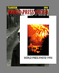 This a detail on the World Press Photo 1994 Yearbook title page, which shows my California firestorm photo of 1993, over the yearbook cover. This image was never printed by the LA Times but I pulled it in my personal edit. While my photograph was the only one on the title page, neither that image nor a second firestorm photo of mine inside the yearbook won an individual category award, but they were included in the thirty-nine country print exhibition tour with the World Press Photos.