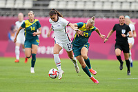 KASHIMA, JAPAN - JULY 27: Alex Morgan #13 of the United States muscles through the midfield before a game between Australia and USWNT at Ibaraki Kashima Stadium on July 27, 2021 in Kashima, Japan.