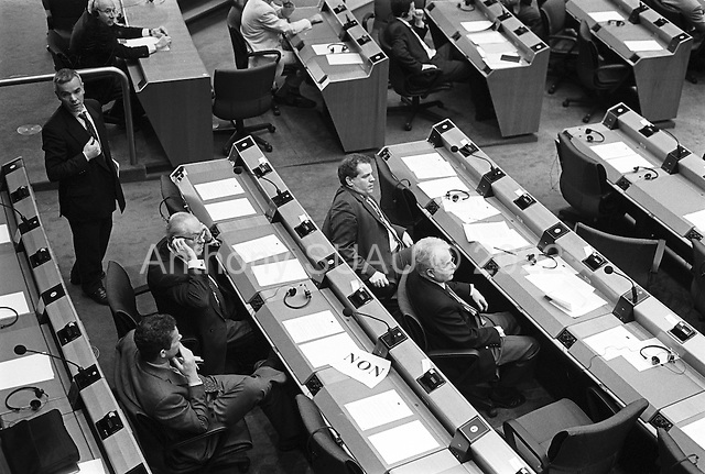 Brussels, Belgium.April 24, 2002..Jean-Marie Le Pen is handed a NON sign when he enters the European Parliament. Protests by workers and Parliament members throughout the building forced him to cancel a press conference.