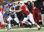 TCU Horned Frogs wide receiver Skye Dawson (11) and Southern Methodist Mustangs running back Zach Line (48) in action during heavy rainfall in the game between the Southern Methodist Mustangs and the TCU Horned Frogs at the Gerald J. Ford Stadium in Dallas, Texas. TCU defeats SMU 24 to 16..