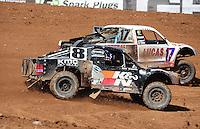 Apr 17, 2011; Surprise, AZ USA; LOORRS driver Carl Renezeder (17) and Kent Brascho (8) during round 4 at Speedworld Off Road Park. Mandatory Credit: Mark J. Rebilas-