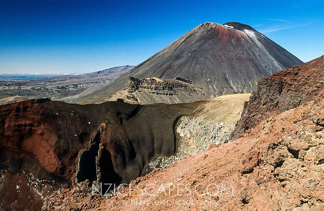 Tongariro Crossing Track among living volcanes. Mt. Ngauruhoe (2291m) dominates the frame with Red Crater bottom left - Tongariro National Park, Central Plateau, New Zealand