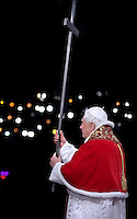 Pope Benedict XVI holds the wooden cross during the Via Crucis (Way of the Cross) torchlight procession on Good Friday in front of the Colosseum in Rome, Friday, April 10, 2009.The evening Via Crucis procession at the ancient Colosseum amphitheater is a Rome tradition that draws a large crowd of faithful, including many of the pilgrims who flock to the Italian capital for Holy Week ceremonies before Easter SundayVia Crucis;