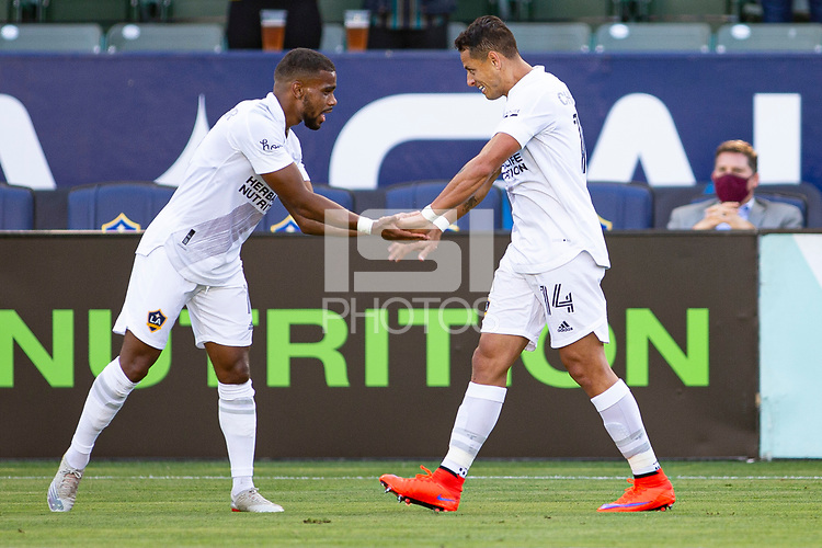 CARSON, CA - MAY 8: Javier Hernandez #14 of the Los Angeles Galaxy celebrates with Samuel Grandsir #11 during a game between Los Angeles FC and Los Angeles Galaxy at Dignity Health Sports Park on May 8, 2021 in Carson, California.
