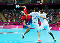 08 AUG 2012 - LONDON, GBR - Jorge Maqueda Pena (ESP) of Spain (left) dives past Nikola Karabatic (FRA) (centre) and William Accambray (FRA) of France (right) to shoot during their men's London 2012 Olympic Games quarter final match at the Basketball Arena in the Olympic Park, in Stratford, London, Great Britain .(PHOTO (C) 2012 NIGEL FARROW)