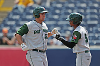 Fort Wayne TinCaps first baseman Brad Zunica (35) is greeted by teammate Rob Boykin (3) after hitting a home run against the West Michigan Michigan Whitecaps during the Midwest League baseball game on April 26, 2017 at Fifth Third Ballpark in Comstock Park, Michigan. West Michigan defeated Fort Wayne 8-2. (Andrew Woolley/Four Seam Images)