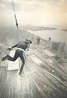 1980 FILE PHOTO - ARCHIVES -<br /> <br /> There he goes! Dar Robinson, the California stuntman, flails his arms and legs as he leaps from the 1,100-foot observation level of the CN Tower, with his life depending only on a wire tether. A crowd of about 250 got this view, right, of Robinson just after he started his leap. A ratchet device slowed his descent and stopped him about 300 feet from the ground.<br /> Bezant, Graham<br /> Picture, 1980<br /> <br /> 1980<br /> <br /> PHOTO : Graham Bezant - Toronto Star Archives - AQP