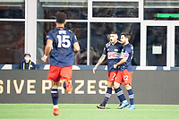 FOXBOROUGH, MA - MAY 22: Gustavo Bou #7 of New England Revolution celebrates his goal against New York Red Bulls during a game between New York Red Bulls and New England Revolution at Gillette Stadium on May 22, 2021 in Foxborough, Massachusetts.