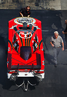 Sep 16, 2017; Concord, NC, USA; NHRA funny car team owner Jim Head (right) stands alongside the car of driver Jonnie Lindberg during qualifying for the Carolina Nationals at zMax Dragway. Mandatory Credit: Mark J. Rebilas-USA TODAY Sports