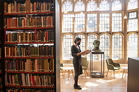 BNPS.co.uk (01202) 558833<br /> Pic: ZacharyCulpin/BNPS<br /> <br /> PICTURED: Museum conservator, Riva Boutylkova pictured in the stunning newly refurbished library<br /> <br /> An important Roman mosaic that has been saved for the nation went on display today at a county museum.<br /> <br /> The Dorset Museum unveiled the 1,700-year-old panel depicting a leopard attacking an antelope that it acquired earlier this year to stop it from going abroad.<br /> <br /> It forms the centrepiece for the venue which is about to reopen following a £16m transformation that has taken three years.