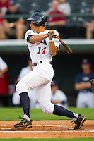 George Springer #14 of Team USA follows through on his swing against Team Korea at Knights Stadium July 16, 2010, in Fort Mill, South Carolina.  Photo by Brian Westerholt / Four Seam Images