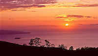 A view of Kaho'olawe and Molokini at sunset, seen from Maui.