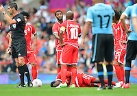 July 26, 2012..UAE's Ahmed Khalil lays on the pitch after getting injured. UAE vs Uruguay Football match during 2012 Olympic Games at Old Trafford in Manchester, England. Uruguay defeat United Arab Emirates 2-1...