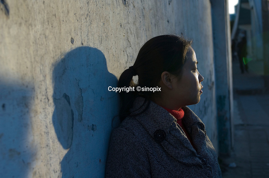 """Fifteen year-old Lou Li cries as she recounts the eight months that she spent forcibly """"married"""" to a farmer in Yunnan, West China. Lou Li was tricked away from her home and sold to the farmer for 6,500 RMB in September 2006 and escaped in April 2007.  Girls in China are increasingly targeted and stolen as there is a shortage of wives as the gender imbalance widens with 120 boys for every 100 girls..PHOTO BY SINOPIX"""