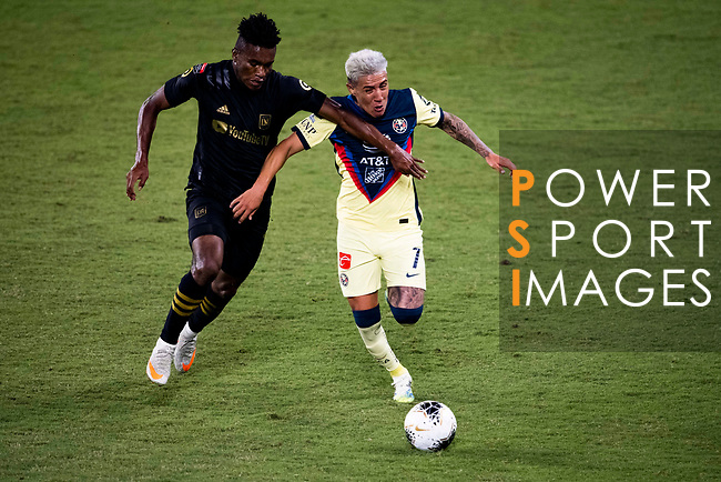 Jose Cifuentes of Los Angeles FC (USA) and Leonardo Suarez of  Club America (MEX) fight for the ball during their CONCACAF Champions League Semi Finals match at the Orlando's Exploria Stadium on 19 December 2020, in Florida, USA. Photo by Victor Fraile / Power Sport Images
