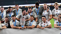 Chris Robshaw of England holds the Cook Cup with team mates after winning the QBE International match between England and Australia at Twickenham Stadium on Saturday 29th November 2014 (Photo by Rob Munro)