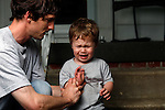 Reprimand in the middle of a portrait session on our front porch. My older son was almost two years old.