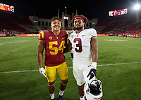 LOS ANGELES, CA - SEPTEMBER 11: Tayler Katoa #54 of the USC Trojans and Levani Damuni #3 of the Stanford Cardinal after a game between University of Southern California and Stanford Football at Los Angeles Memorial Coliseum on September 11, 2021 in Los Angeles, California.