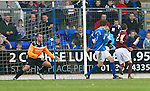 St Johnstone v Hearts....24.03.12   SPL.Jason Holt beats Alan Mannus to score for Hearts.Picture by Graeme Hart..Copyright Perthshire Picture Agency.Tel: 01738 623350  Mobile: 07990 594431