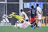 FOXBOROUGH, MA - MAY 22: Carlos Coronel #13 of New York Red Bulls deflects a Carles Gil #22 of New England Revolution shot at the New York Red Bull's goal during a game between New York Red Bulls and New England Revolution at Gillette Stadium on May 22, 2021 in Foxborough, Massachusetts.