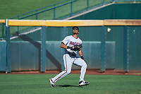 Surprise Saguaros right fielder LaMonte Wade (15), of the Minnesota Twins organization, prepares to catch a fly ball during an Arizona Fall League game against the Mesa Solar Sox on October 20, 2017 at Sloan Park in Mesa, Arizona. The Solar Sox walked-off the Saguaros 7-6.  (Zachary Lucy/Four Seam Images)