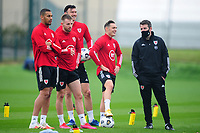 Connor Roberts of Wales laughs with sports scientist Ronan Kavanagh during the Wales Training Session at The Vale Resort in Cardiff, Wales, UK. Monday 5 October 2020