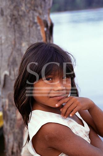 Mato Grosso, Brazil. Young Rikbaktsa (Canoeiro) Indian girl in ragged t-shirt.
