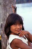 Mato Grosso, Brazil. Young Rikbaktsa (Canoeiro) Indian girl in ragged t-shirt.
