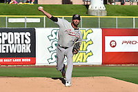 Matt Buschmann (10) of the Sacramento River Cats warms up in the outfield prior to the game against the Salt Lake Bees at Smith's Ballpark on June 6, 2014 in Salt Lake City, Utah.  (Stephen Smith/Four Seam Images)