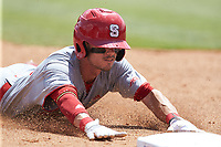 Josh McLain (15) of the North Carolina State Wolfpack dves head first into third base during the game against the Northeastern Huskies at Doak Field at Dail Park on June 2, 2018 in Raleigh, North Carolina. The Wolfpack defeated the Huskies 9-2. (Brian Westerholt/Four Seam Images)