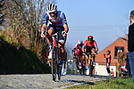 The peloton including Mads Pedersen (BEL) Trek-Segafredo gives chase on Oude Kwaremtont during the 73rd edition of Kuurne-Brussel-Kuurne 2021 running 197km from Kuurne to Kuurne, Belgium. 28th February 2021  <br /> Picture: Serge Waldbillig | Cyclefile<br /> <br /> All photos usage must carry mandatory copyright credit (© Cyclefile | Serge Waldbillig)