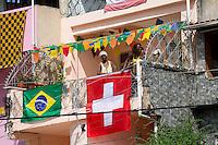 A flat near Arena Fonte Nova displays a Brazil and Switzerland flag