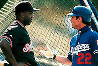 Barry Bonds of the San Francisco Giants talks with Brett Butler of the Los Angeles Dodgers before a game at Dodger Stadium in Los Angeles, California during the 1997 season.(Larry Goren/Four Seam Images)