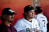Luke Voit (30) of the Missouri State Bears stands in the dugout during a game against the Purdue Boilermakers at Hammons Field on March 13, 2012 in Springfield, Missouri. (David Welker / Four Seam Images)