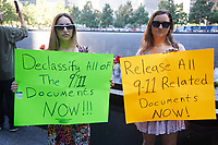 Two women hold signs calling for the declassification of all 9/11-related documents on the 20th anniversary of the September 11, 2001 terrorist attack on the World Trade Center and the Pentagon in New York, New York, on Saturday, September 11, 2021.<br /> CAP/MPI/RS<br /> ©RS/MPI/Capital Pictures
