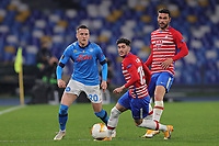 Piotr Zielinski of SSC Napoli and Carlos Neva of Granada CF compete for the ball during the Europa League round of 32, 2nd leg football match between SSC Napoli and Granada CF at Diego Armando Maradona stadium in Napoli (Italy), February 25, 2021.<br /> Photo Cesare Purini / Insidefoto