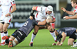 Ospreys flanker James King tackles Ulster hooker Rory Best.<br /> Guiness Pro12<br /> Ospreys v Ulster<br /> 20.12.14<br /> ©Steve Pope -SPORTINGWALES