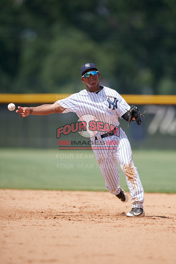 GCL Yankees West shortstop Roberto Chirinos (32) throws to first base during a game against the GCL Yankees East on August 8, 2018 at Yankee Complex in Tampa, Florida.  GCL Yankees West defeated GCL Yankees East 8-4.  (Mike Janes/Four Seam Images)