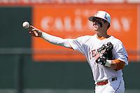 Texas Longhorns second baseman Brooks Marlow #8 makes a throw to first base against the Oklahoma Sooners in the NCAA baseball game on April 6, 2013 at UFCU DischFalk Field in Austin, Texas. The Longhorns defeated the rival Sooners 1-0. (Andrew Woolley/Four Seam Images).