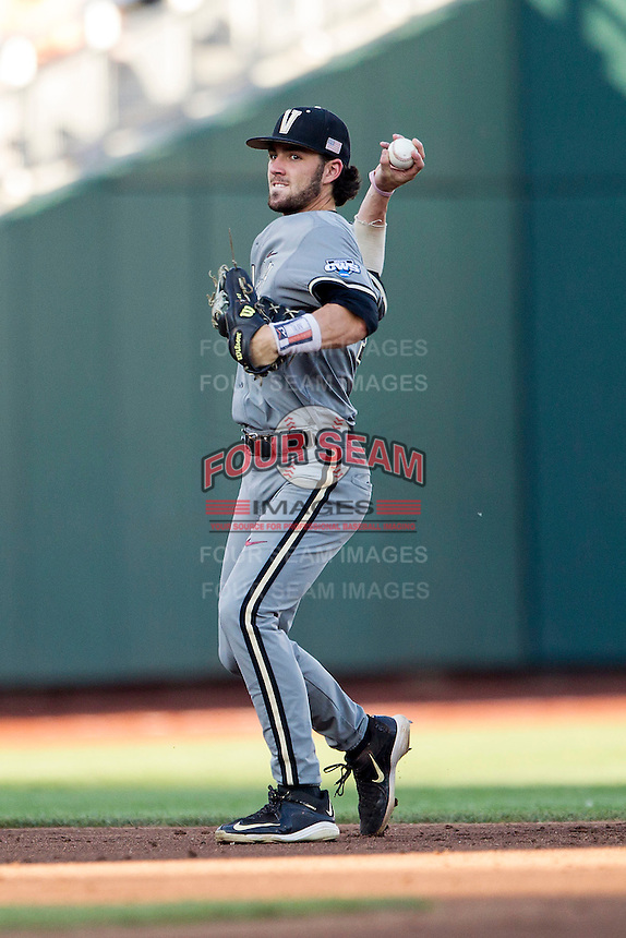 Vanderbilt Commodores shortstop Dansby Swanson (7) makes a throw to first base during the NCAA College baseball World Series against the TCU Horned Frogs on June 16, 2015 at TD Ameritrade Park in Omaha, Nebraska. Vanderbilt defeated TCU 1-0. (Andrew Woolley/Four Seam Images)